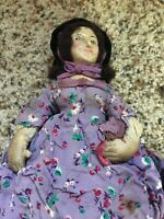 Antique Doll With Purple Flowered Dress