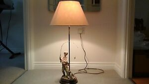 Table lamp with fisherman ornament by Vivien C