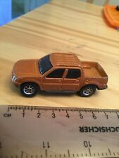 Maisto 11001 Ford Sport Trac Pickup in Metallic Brown scale 1:64