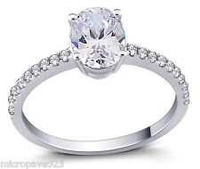 White Oval Shaped Cubic Zirconia Solitaire Ring With Pave Setting Sterling 925