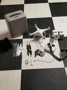 DJI Phantom 4 Drone Quadcopter P4 with 4 batteries, remote, and xtra props