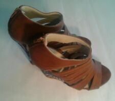BROWN CHARMING CHARLIE WEDGE SANDLE SHOES. UNIQUE CLOTH PATTERN COVERING WEDGE.
