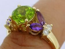 R233- Solid 9K Gold Natural Peridot, Amethyst & Diamond Suffragette Ring size N