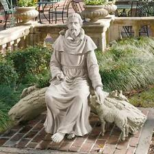 Saint Francis of Assisi Seated on Log Statue Near Life-Size Garden Sculpture