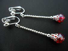 A PAIR OF  LONG DANGLY RED  CRYSTAL TEARDROP  SILVER PLATED CLIP ON EARRINGS.