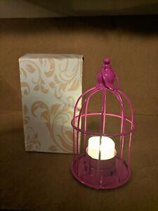 Pink birdcage lantern centerpiece