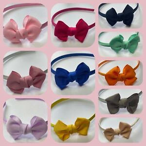 Girls Alice band with a sweet double bow school hair band lots of colours