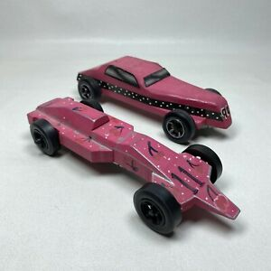 Lot of TWO (2) Pink Pinewood Derby Cars Weighted Incomplete For Parts or Repair