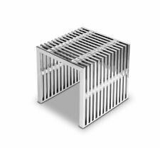Stainless steel ottoman seat cube with transparent acryl glass distance pieces.