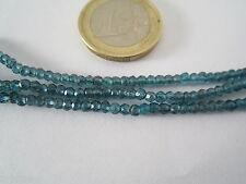 1 filo di zirconi color blu chiaro forati e sfaccettati 3 x 2,5 mm lungo 33 cm