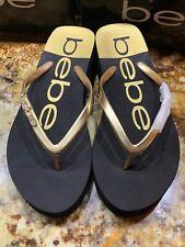 Bebe Women's Thong Flip Flops Sandals Size 7 US Black Gold With Embellishment