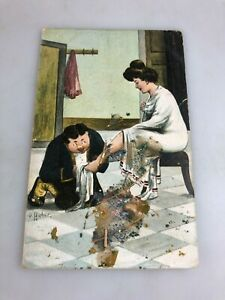 VINTAGE POSTCARD - COLOUR NOT USED - MAN WASHING A LADIES FOOT