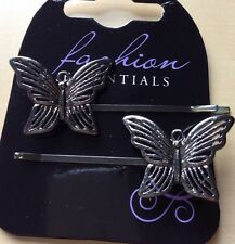 une paire de JOLI gris métallique motif papillon épingle à cheveux