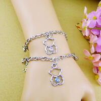 A pair of his & hers matching teddy bear with hearts charm bracelets