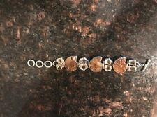Three Ammonites and 8 topaz solid sterling bracelet