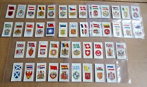 SELECTION OF SLEEVES OF NATIONAL FLAGS AND  ARMS PLAYERS CIGARETTE CARDS  1936