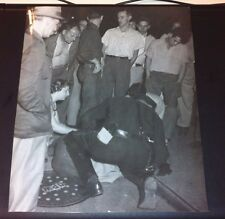 VINTAGE  PHOTO 8X10 BLACK AND WHITE OF OFFICER HELPING SOMEONE IN CROWD