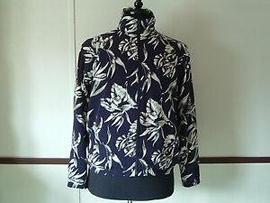 EP Pro brand  blue jacket with tan leaf pattern size  womens small golf wear