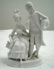 WHITE BISQUE COLONIAL WOMEN AND MAN BUD VASE FIGURINE MADE IN GERMANY