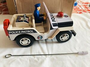 TIN TOY NOMURA JEEP POLICE MADE IN JAPAN NEW!!!!