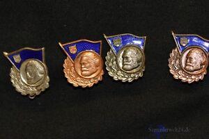 4 Stück alte frühes DDR Abzeichen für gutes Wissen in Bronze und Silber
