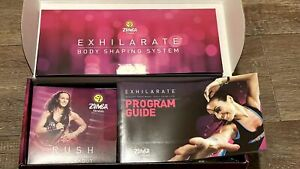Zumba Fitness Exhilarate! 5 DVD SET + Guide & Two Toning Sticks - Complete