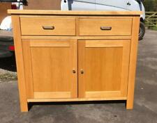 A TALL 2 DOOR 2 DRAWER OAK SIDEBOARD. PLENTY OF STORAGE WITH EASY GLIDE DRAWERS