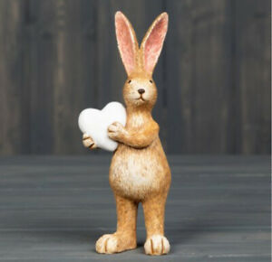 A Sweet Standing Resin Bunny rabbit ornament with  holding a Small White Heart