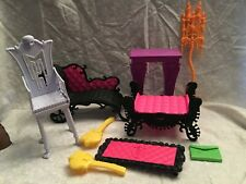 Monster High furniture.  Couch, chair, bench, mantle, hair brushes and more.