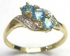 SYTRUEMECO 9KT YELLOW GOLD ROUND BLUE TOPAZ & DIAMOND RING   SIZE 7   R997