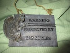 Protected By Gargoyles Sign