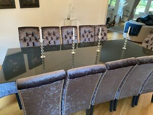glass extending dining table and 12 Chairs
