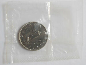 1968 Canadian dollar MS-67 condition in original packaging