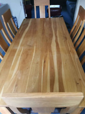 Solid oak wood dining table with 6 chairs.