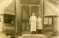 RPPC STORE FRONT w MAN & GIRL - REAL PHOTO POSTCARD (trimmed) SYRACUSE NY 1914