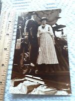 Historic vintage real photo Man Woman on Steam locomotive train RPPC Postcard