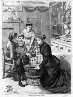 MOTHER AND CHILDREN STIRRING CHRISTMAS PUDDING, ANTIQUE