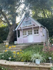 2 storey pink wooden playhouse 8ft X 8ft