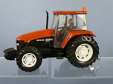 BRITAINS MODEL No.9490 NEW HOLLAND M160 TRACTOR WITH DRIVER