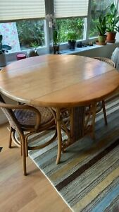 Cane-style wooden, tan-coloured, circular table 2 chairs and 1 shelf