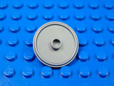 LEGO-MINIFIGURES SERIES X 1 SILVER ROUND SHIELD WITH RAISED STUD IN MIDDLE PART