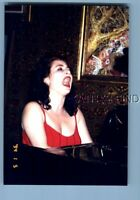 FOUND COLOR PHOTO E+0598 PRETTY WOMAN SITTING WITH MOUTH OPEN AT PIANO