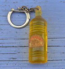 Porte-clé des années 1960, Huile pure d'arachide Coop, étiquette abîmée