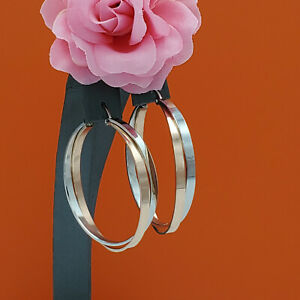Women's Two Color Stainless Steel Hoop Earrings. Silver and 18K Rose Gold