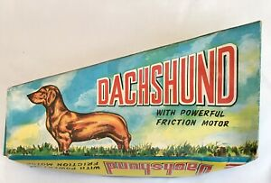 1960s Hong Kong Guiterman plastic Friction Daschund Slinky Dog Empire Made