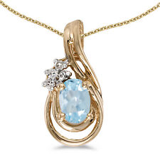 "14k Yellow Gold Oval Aquamarine and Diamond Pendant With 18"" Chain"