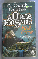 A Dirge for Sabis by C.J. Cherryh, Leslie Fish (1989 paperback)