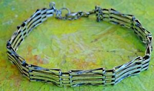 Lovely vintage solid sterling silver gate bracelet with safety chain