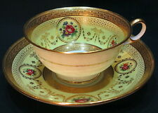 ANTIQUE TIFFANY BY CAULDON YELLOW AND RAISED GOLD CUP AND SAUCER