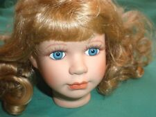 bisque head Leonardo Collection with wig